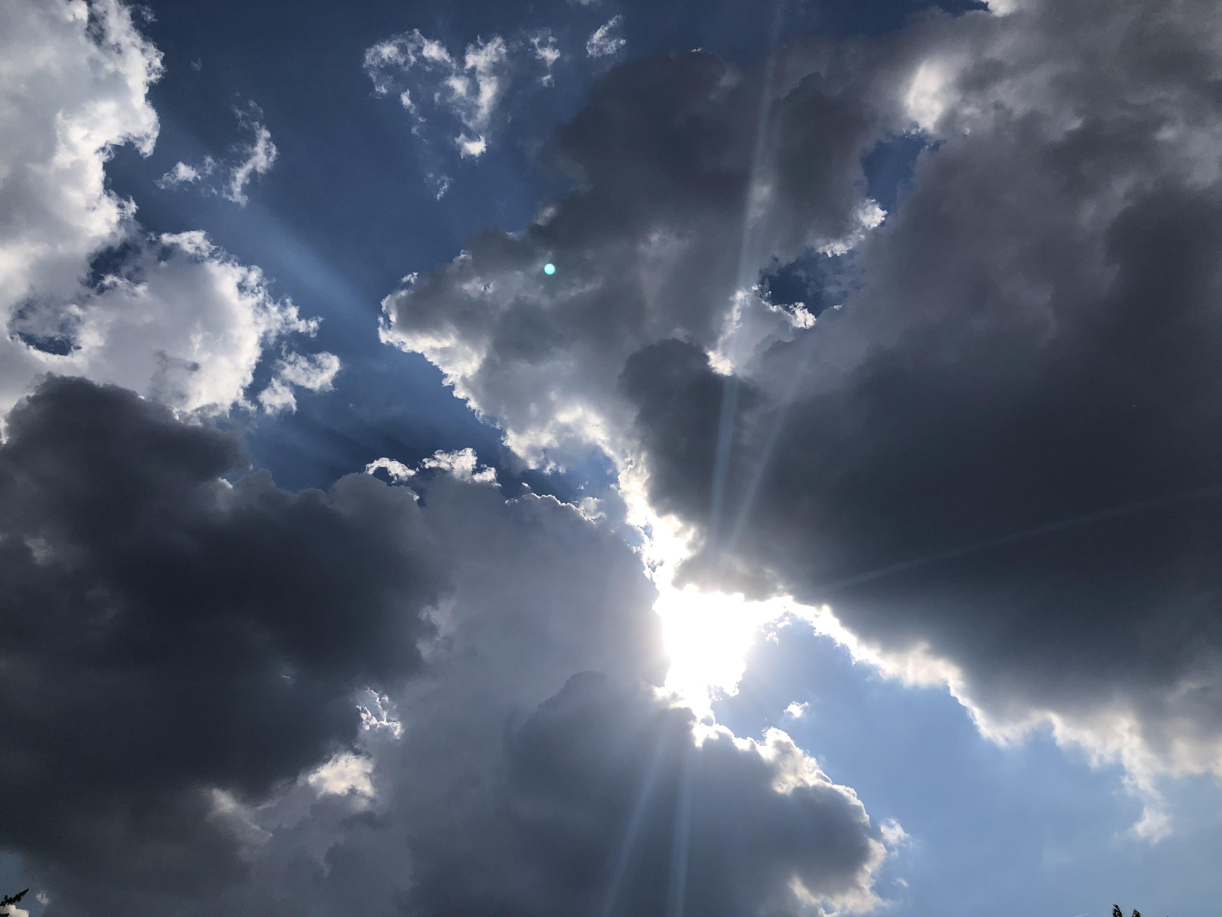 Sun-breaking-through-clouds